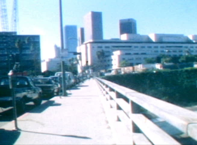 LOS ANGELES, CALIFORNIA - OCTOBER 11:  Vintage super 8 moving time lapse of the downtown LA civic center area on Broadway on October 11, 1988 in Los Angeles, California.