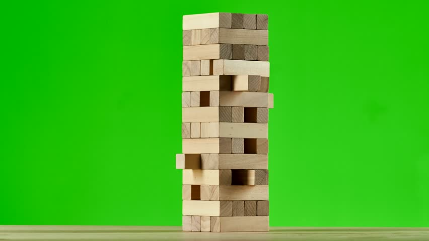 Wooden puzzles jenga gather in tall tower. Stop motion, green screen