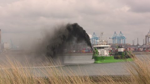 ROTTERDAM SEAPORT - MAY 2017: dredging operation of hopper dredger Reynaert, rainbowing black mud when the deepening of Alexia Haven, Maasvlakte II