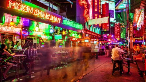 BANGKOK, THAILAND - MARCH 22nd: Timelapse of the red light district Soi Cowboy at night in Bangkok, Thailand on March 22nd, 2017.