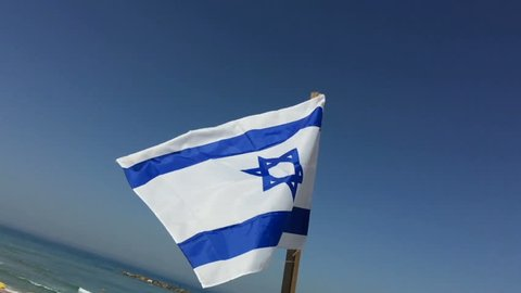 Israel Flag close up slow motion with Tel Aviv Beach in the background
