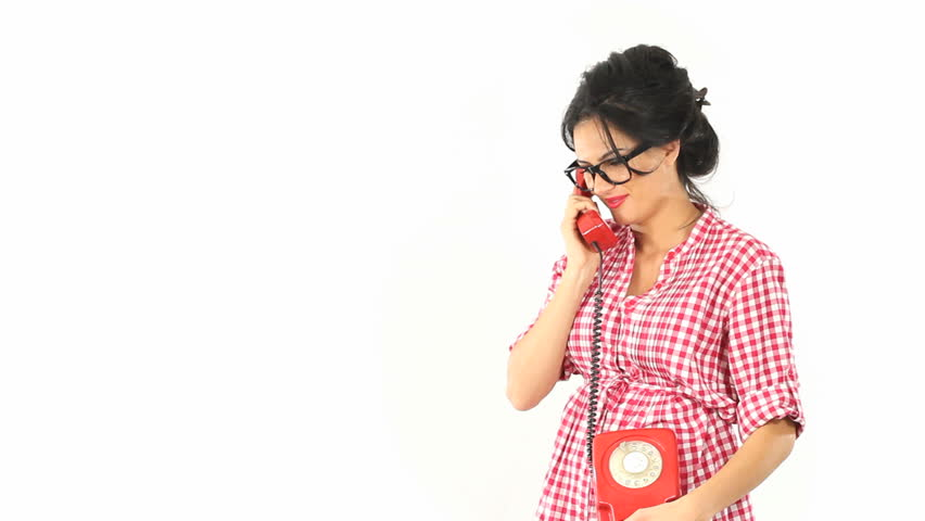 Gossip girl arguing - Vintage pinup style dressed young woman fighting over the phone, shot on white background