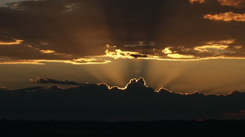 Spectacular sunrises over ominous thunderstorm on the horizon. HD 1080p time lapse.