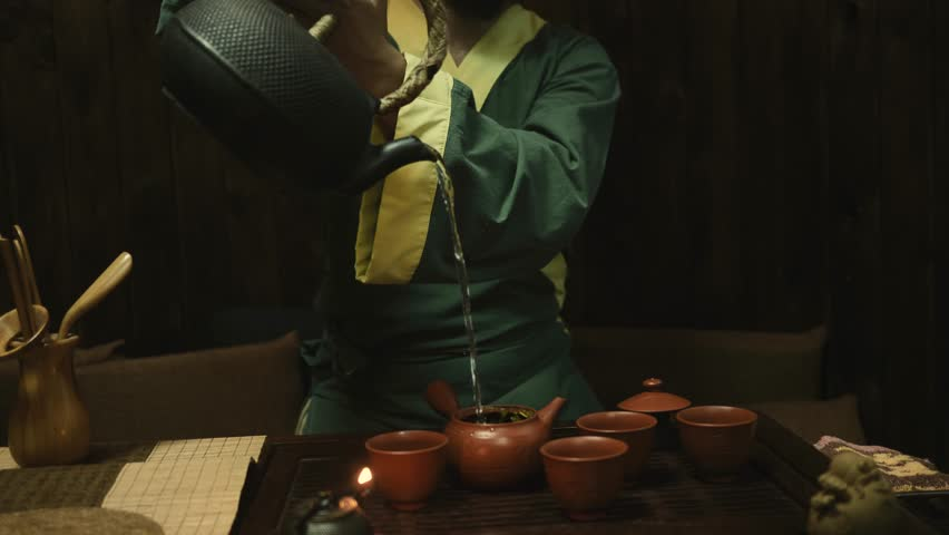 Traditional chinese tea ceremony on the tea table, close up, slow motion, dolly shot