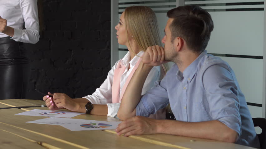 Bussiness, meeting and education - businesswoman with flipchart in office. | Shutterstock HD Video #28342453