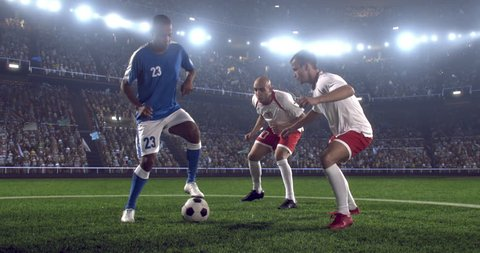 4k footage of a soccer player in dramatic play during a soccer game on a professional outdoor soccer stadium. Players wear unbranded uniform. Stadium and crowd are made in 3D.