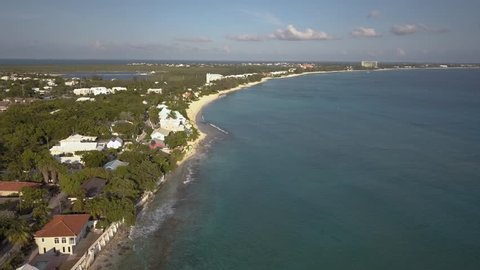 Flying over the tropical, Caribbean Seven Mile Beach on Grand Cayman