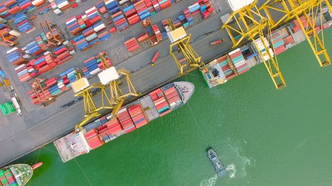 container cargo ship, import export, business logistic supply chain transportation concept for shipping aerial view 90 degree dolly tracking shot background, 4K