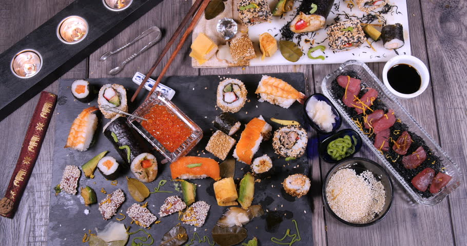 Top down zoom in view of an assortment of Japanese food: sushi, nigiri, sashimi, rolls | Shutterstock HD Video #28379263