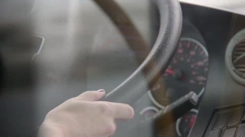 Woman bus driver steering wheel