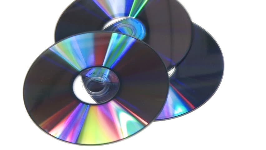 Computer CD DVD rotating on white background