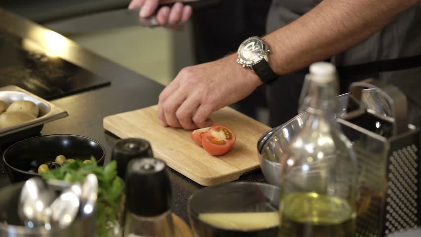 Cook cutting tomatoes with knife | Shutterstock HD Video #28431193