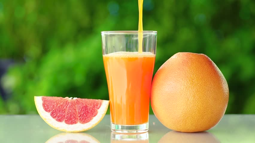 Grapefruit Juice in the Garden  Stock Footage Video (100% Royalty-free)  28451923 | Shutterstock