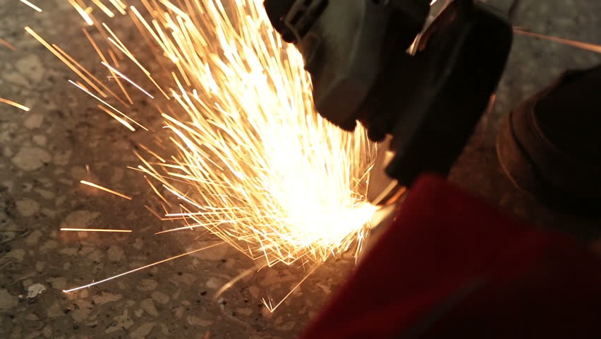 Sparks are coming out from a grinder while an employee cutting a steel tube. Real 1080p HD video shot with Canon 5D Mark III.