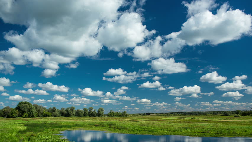 time lapse with running clouds with reflection in water and deep blue sky #2848399