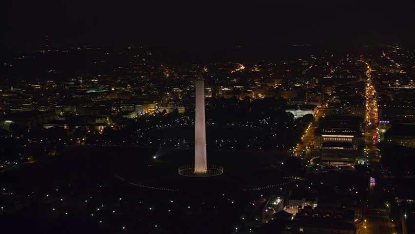 Washington, D.C. circa-2017, Aerial view of the Washington Monument and Capitol Mall area at night. Shot with Cineflex and RED Epic-W Helium.