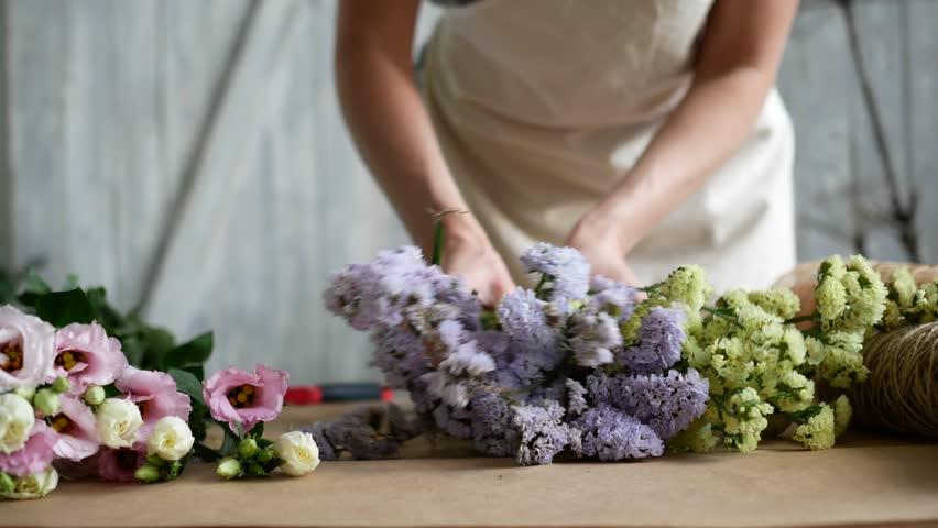 Woman florist makes flower bouquet | Shutterstock HD Video #28502803