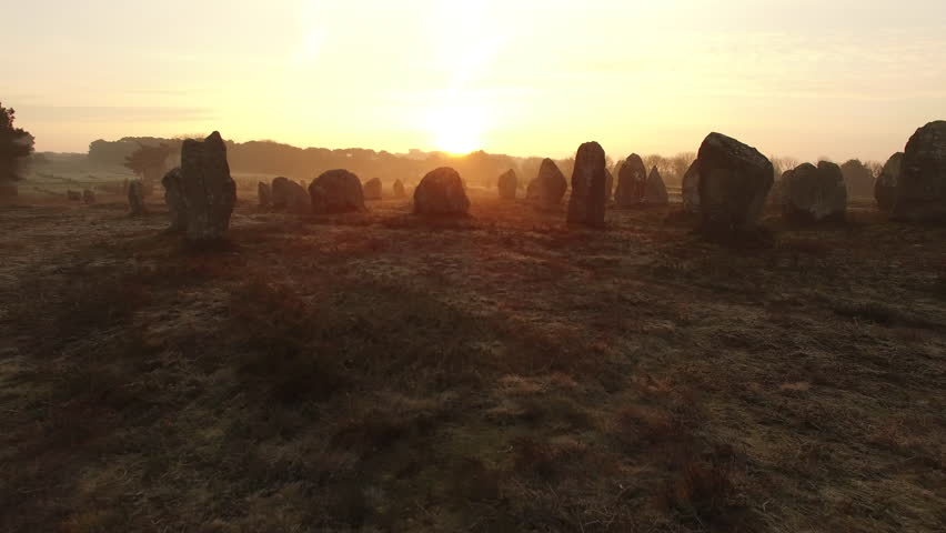 "Flying over the famous ""Alignements de Carnac"" located in Carnac, Morbihan, Brittany, France. Sunrise on the Megaliths of Kermario, one of the largest Megalithic complex in the world."