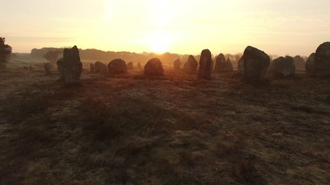 """Flying over the famous """"Alignements de Carnac"""" located in Carnac, Morbihan, Brittany, France. Sunrise on the Megaliths of Kermario, one of the largest Megalithic complex in the world."""