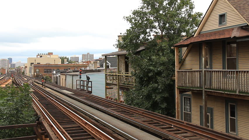 Chicago L Train. Chicago elevated rail passing closely to apartments near the Addison station.