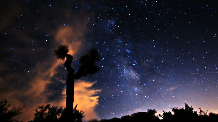 Gorgeous long-exposure time lapse shot of the Milky Way and Stars Galaxy. Passing over Joshua Tree Desert.