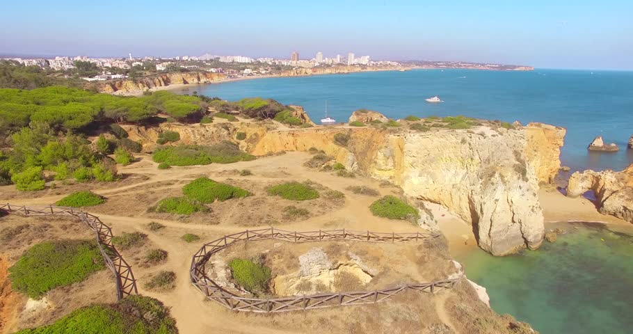 Aerial view of cliffs and beach Praia in Portimao, Algarve region, Portugal