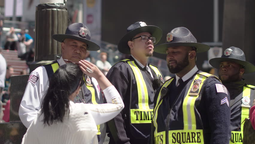 New York, Usa, 05.05.2017. New York police in a crowd of tourists in Times Square
