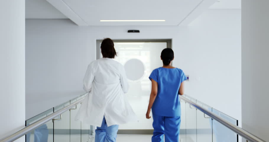 Doctor and nurse running in passageway of hospital during emergency #28633843