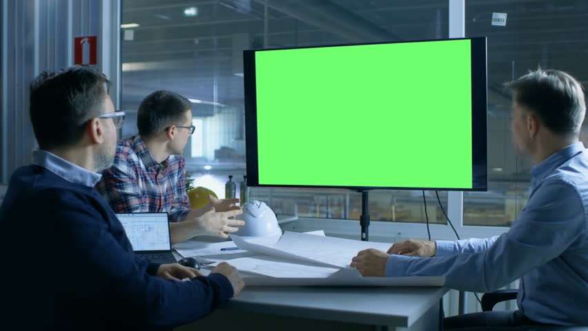 Team of Industrial Engineers Have Important Meeting. Presentation Display Shows Mock-up Green Screen. In the Background Factory is Seen. Shot on RED EPIC-W 8K Helium Cinema Camera. #28698403