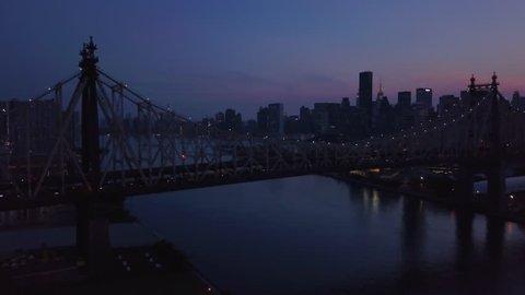dusk clockwise orbiting Queensboro Bridge