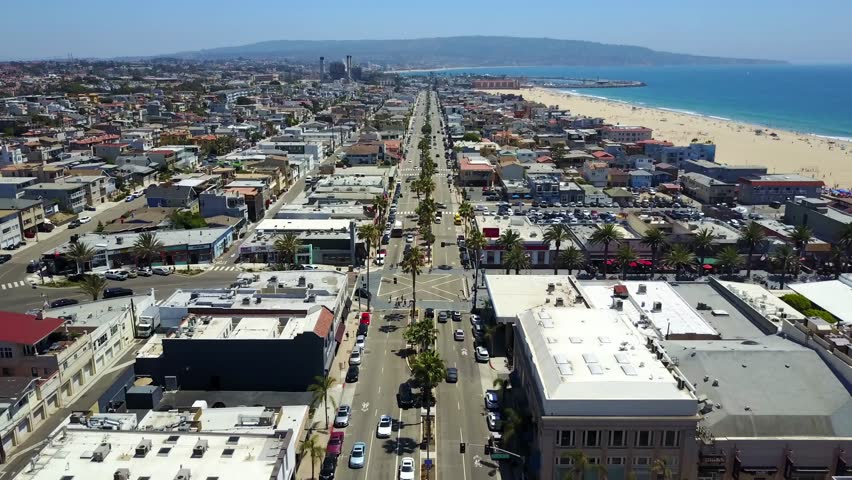 Aerial views looking down over Hermosa beachfront property California traffic street