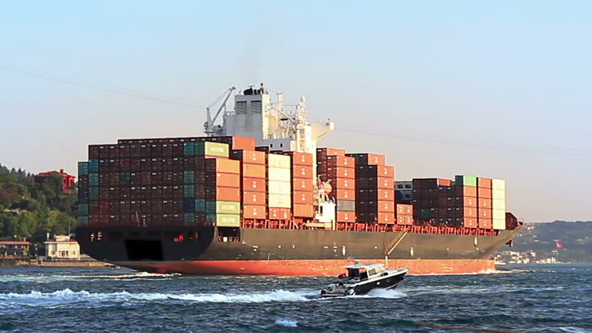 Cargo ship full of containers sailing from Black Sea. Container Transportation