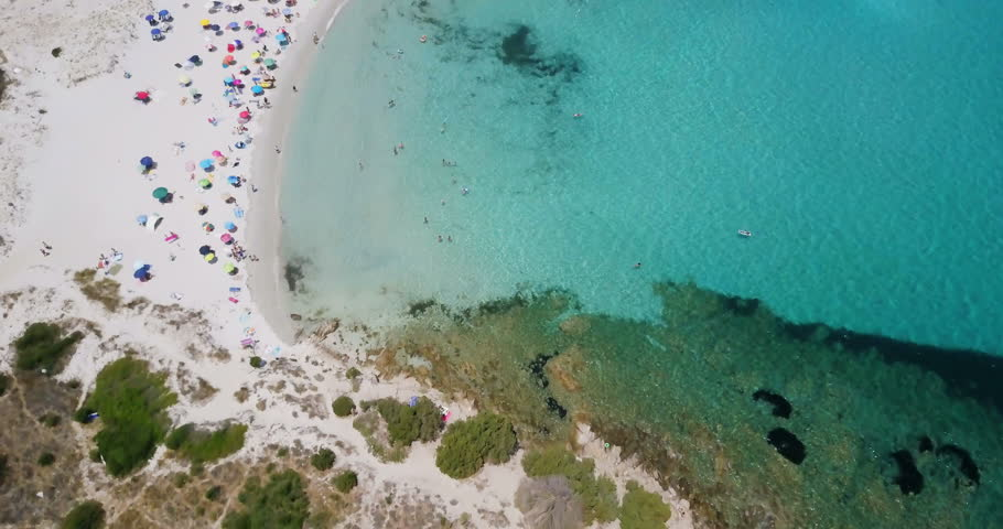 Amazing aerial view of a sunny summer day in Spiaggia Rena Bianca, Sardinia, Italy.