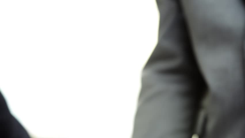 Business Handshake two businessman shaking hands closeup motion track high definition   Shutterstock HD Video #2876614