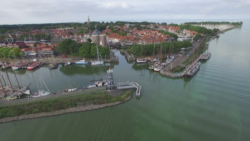 Aerial circling harbour of historical town at lake,Enkhuizen,Netherlands