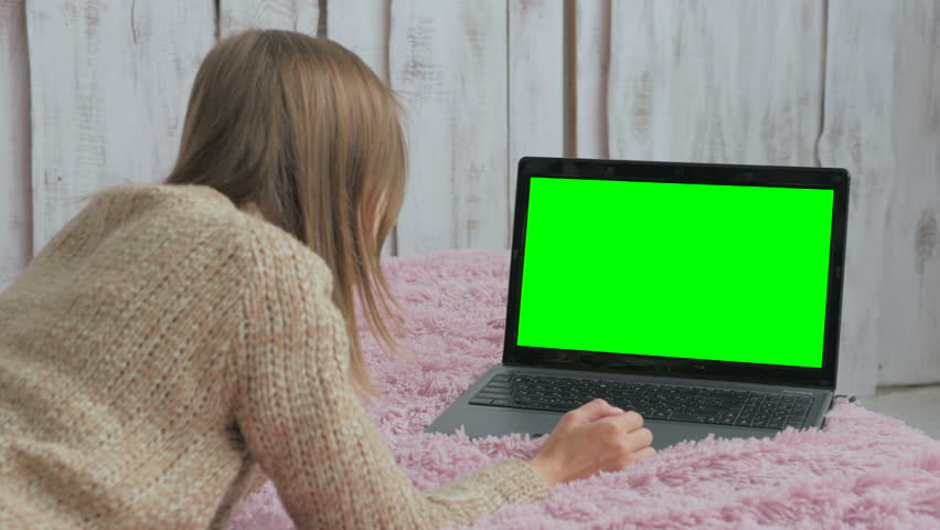 Woman using laptop with green screen. Business, communication, freelance and internet concept | Shutterstock HD Video #28809136