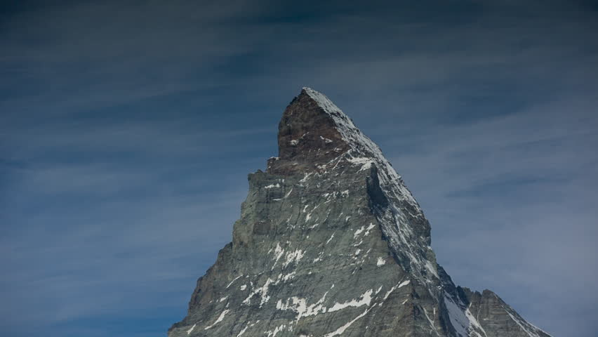 zooming video of the amazing matterhorn and surrounding mountains in the Swiss Alps with fantastic cloud formations