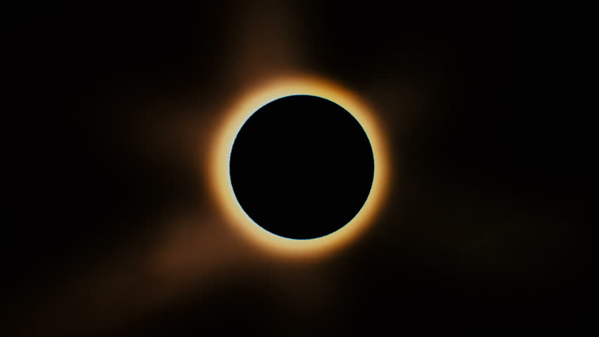 Full solar eclipse. The Moon mostly covers the visible Sun creating a diamond ring effect. This astronomical phenomenon can be seen as a sign of the End of the World. | Shutterstock HD Video #28907413