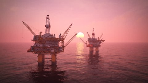 02834 Two offshore platforms or oil rigs at sunset pink sky