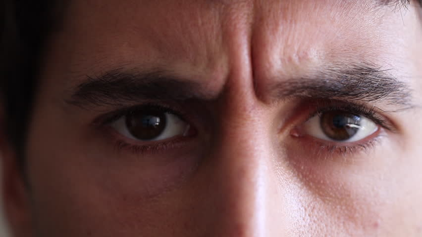 Man has a serious look on his face. Closeup of man frowning and with an angry face. Closes eyes with unbelief