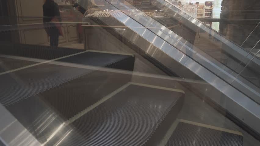 Close-up view of an escalator's mechanical steps. alternately ascending and descending at a popular public shopping center. Video 4k UltraHD | Shutterstock HD Video #28964443