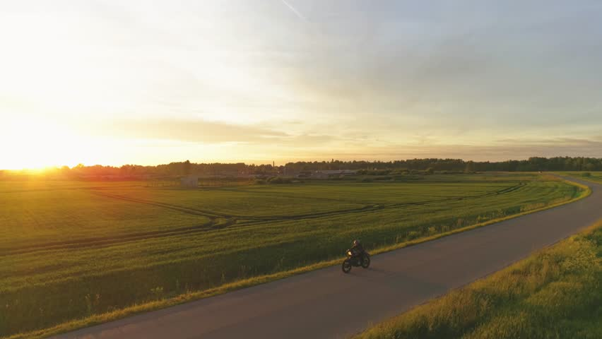 Riding vintage custom made cafe racer on a sunset   Shutterstock HD Video #28978903