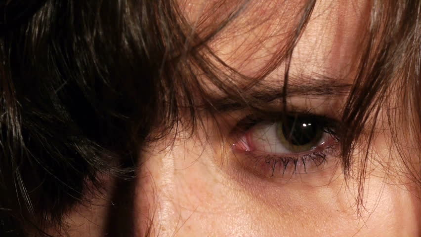 demented woman drug addict dilated eye closeup