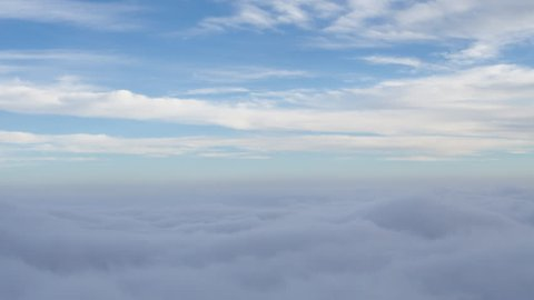 4K time lapse of blue sky and wispy clouds above a layer of inversion cloud tops in shadow isolated in the sky