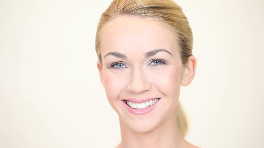 Blonde woman smiling facing forwards
