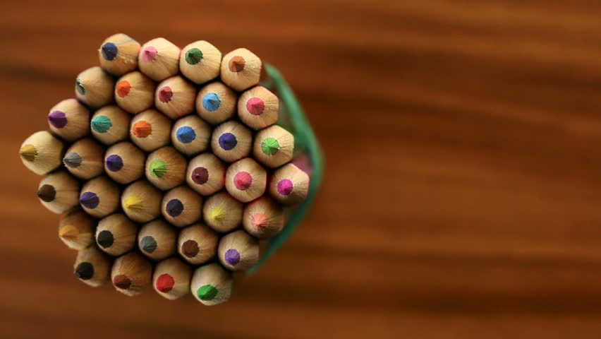 Many multicolored pencils move in a circle on a black wooden background. Concept office or school, knowledge day, the first of September. Video footage is spinning rotate | Shutterstock HD Video #29052247
