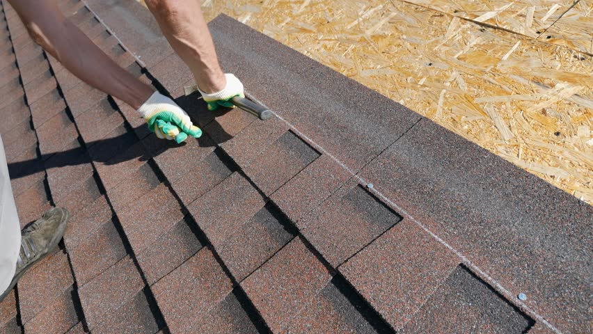 Construction of the roof. Soft roof, shingles. Roofer.