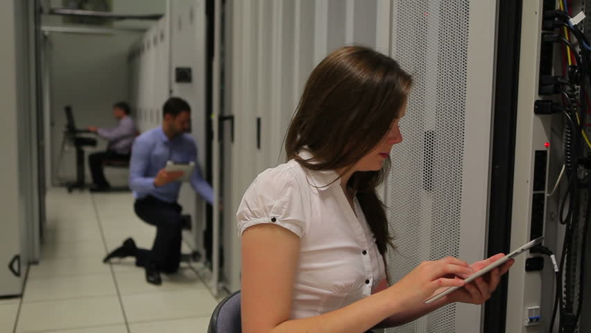Woman doing server maintenance with tablet pc in hallway   Shutterstock HD Video #2908327