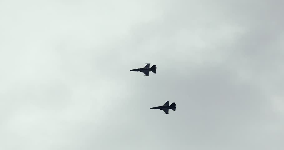Video footage of silhouette of two fighter jet flying on the sky in Indonesian air show, shot in 4k resolution