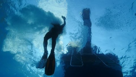 boat underwater scuba diver jumps into water